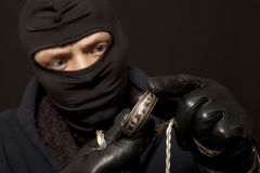 Thief with a silver bracelet Royalty Free Stock Image