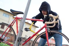 Thief stealing a bike in the city street Stock Images