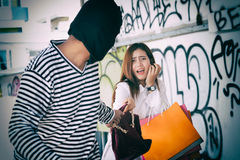 Thief stealing a black leather backpack stealing Stock Image