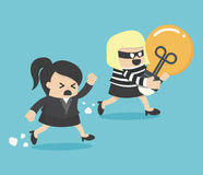 Thief stealing bulb from another BusinessWoman Stock Photos