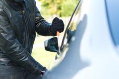 Thief stealing a car Stock Photos