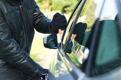 Thief stealing a car Stock Images