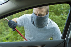 Thief stealing a car Royalty Free Stock Photo