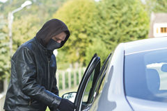 Thief stealing a car Royalty Free Stock Image