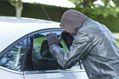 Thief stealing a car Royalty Free Stock Images