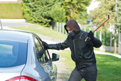 Thief stealing a car Stock Image