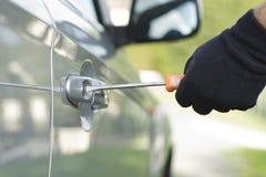 Thief stealing a car Royalty Free Stock Photos