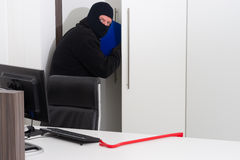Thief stealing company info Royalty Free Stock Image