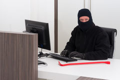 Thief stealing company info Stock Photo
