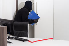Thief stealing company info Stock Images