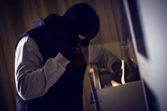 Thief stealing documents royalty free stock image