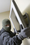 Thief Stealing Flat Screen Television Stock Photo
