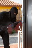 Thief stealing from a house Stock Photography