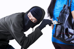 Thief stealing money Royalty Free Stock Image