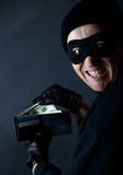 Thief stealing Stock Photo