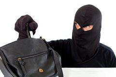 Thief stealing Royalty Free Stock Photo