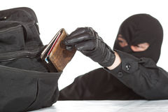Thief stealing a wallet. And a bag on a white background royalty free stock images
