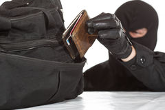 Thief stealing a wallet. And a bag on a white background stock image