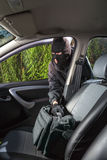 Thief steals bag from the car stock image