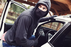 Thief steals car royalty free stock photo