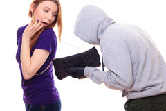 Thief steals woman's purse Royalty Free Stock Photo