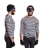 Thief stereotype. Front and side. Thief stereotype. Portrait isolated on white background Stock Images
