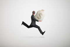 Thief stole the bag with money. And running away over light grey background Royalty Free Stock Images
