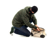 Thief  with stolen bag Stock Image