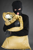 Thief with stolen goods. Royalty Free Stock Photo
