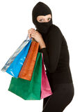 Thief with stolen shopping bags Royalty Free Stock Photography