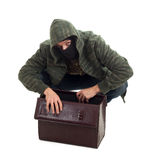 Thief with stolen suitcase Stock Photo