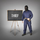Thief text on blackboard with thief Royalty Free Stock Photography