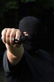 Thief threatening with a gun Stock Photos