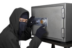 Thief trying to open safe-deposit box Stock Image