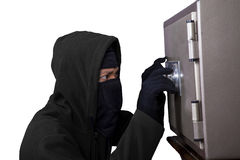 Thief trying to open a safe. Portrait of a robber trying to open a safe isolated over white Stock Images