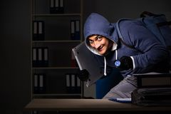 The thief trying to steal personal data in identity theft concept. Thief trying to steal personal data in identity theft concept stock photography