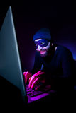 Thief using computer to steal Royalty Free Stock Images