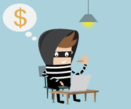 Thief using fake credit card on internet Royalty Free Stock Image