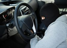Thief using screwdriver in car Stock Photo