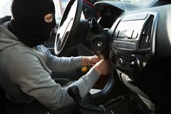 Thief using screwdriver in car Stock Images