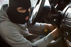 Thief Using Screwdriver In Car royalty free stock photography