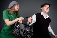 Thief steals a bag Royalty Free Stock Photography