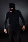 Thief wearing a balaclava Stock Photo