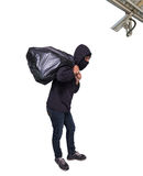 Thief wearing a balaclava black surrendered stealing valuables b Stock Image