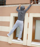 Thief at work. Thief climbing to a house balcony royalty free stock photo