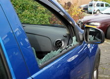 Thiefs have broken a car window to steel items. Inside stock photos