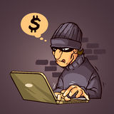 Thieft. A thieft in front of laptop hacking a system Royalty Free Stock Photo