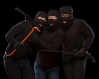 Thieves in masks Stock Photos