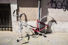 Thieves stole the wheels from a bicycle. A bicycle connected to a pole and the thieves stole the wheels royalty free stock images