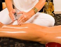 Thigh massage Stock Image